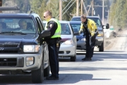 Cst Dan Markevich of the West Kootenay IRSU checks a motorist Sunday afternoon.  Bruce Fuhr photo